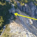 Outcrop and adit (arrow) of the Mountain Boy vein